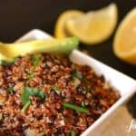 a white bowl of quinoa and black rice salad