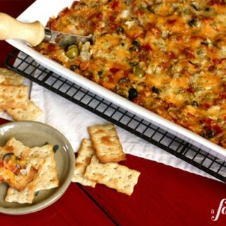 Hot Pizza Dip being served on crackers