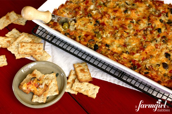 A big tray of Pizza Dip surrounded by crackers