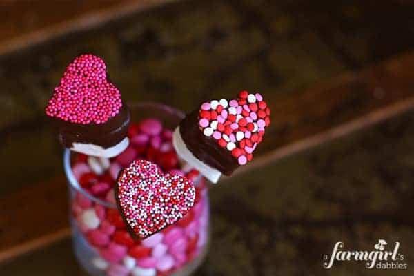 heart shaped marshmallow pops dipped in chocolate and sprinkles