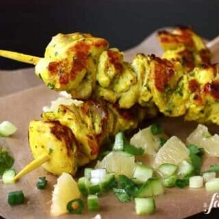 grilled chicken kebabs with a side of lemon salsa