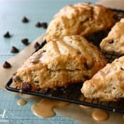 Chocolate chip scones with peanut butter drizzle on a cooling rack