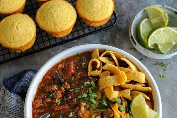 Slow Cooker Chili from afarmgirlsdabbles.com - Homemade chili is easy to make with this crockpot chili recipe, giving you bowls of fantastic classic chili flavor. Garnish with your favorite toppings for all the delicious fun! #chili #slowcooker #crockpot #beef #turkey #fritos #beans #cheese #comfortfood