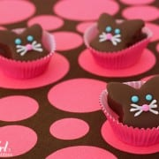 Chocolate dipped marshmallow bunnies in baking cups