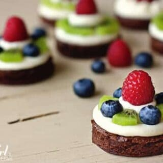 brownie circles topped with almond cream cheese and fresh fruit