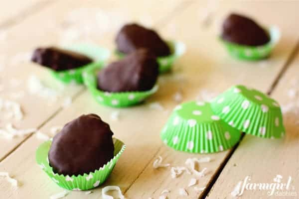Chocolate dipped coconut marshmallow eggs in a green polka-dot baking cups