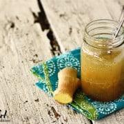 a jar of ginger dressing with fresh ginger
