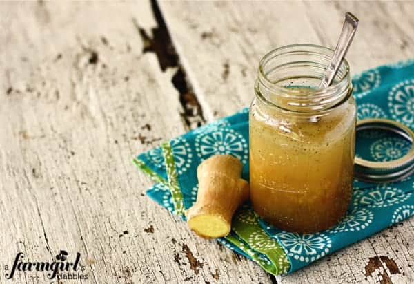 a jar of ginger dressing with fresh ginger