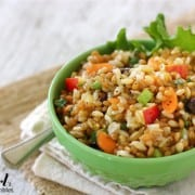 a bowl of three grain and vegetable salad