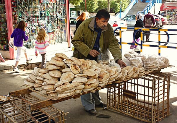 a man selling pita bread in Egypt