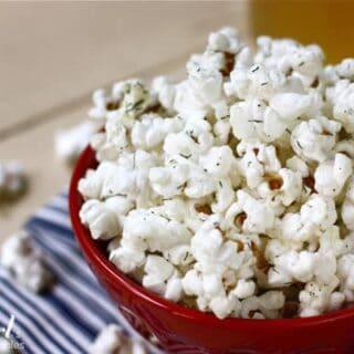 a red bowl of seasoned Popcorn
