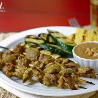 beef skewers and grilled vegetables with peanut dipping sauce