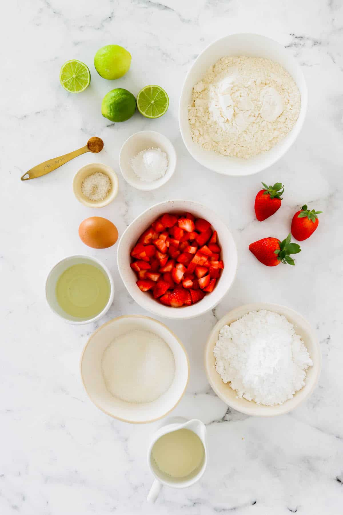 Overhead view of homemade strawberry muffin ingredients