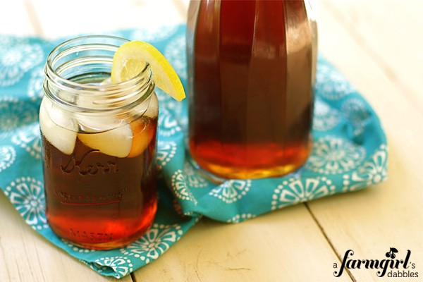 a pitcher and glass of iced tea