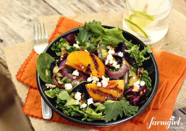 grilled peach slices on a salad