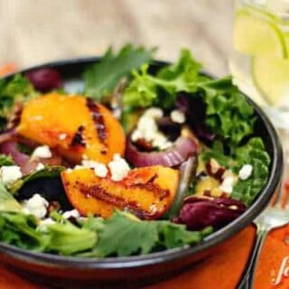a salad with grilled peaches and onions