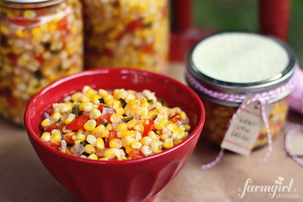 a red bowl of corn relish