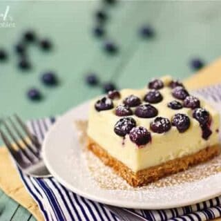 These cheesecake bars are so creamy and made with fresh blueberries and white chocolate.