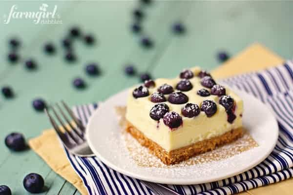 a cheesecake bar topped with blueberries