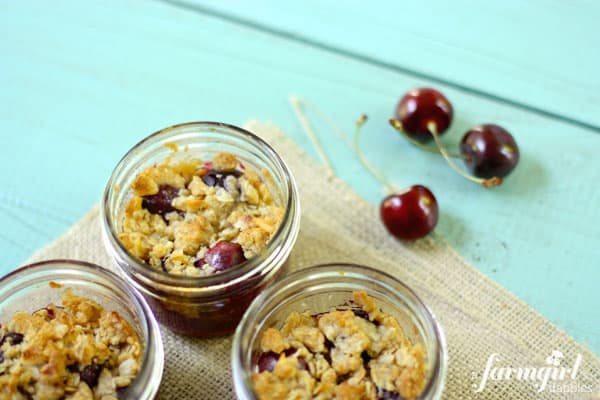 glass jars with cherry crumble