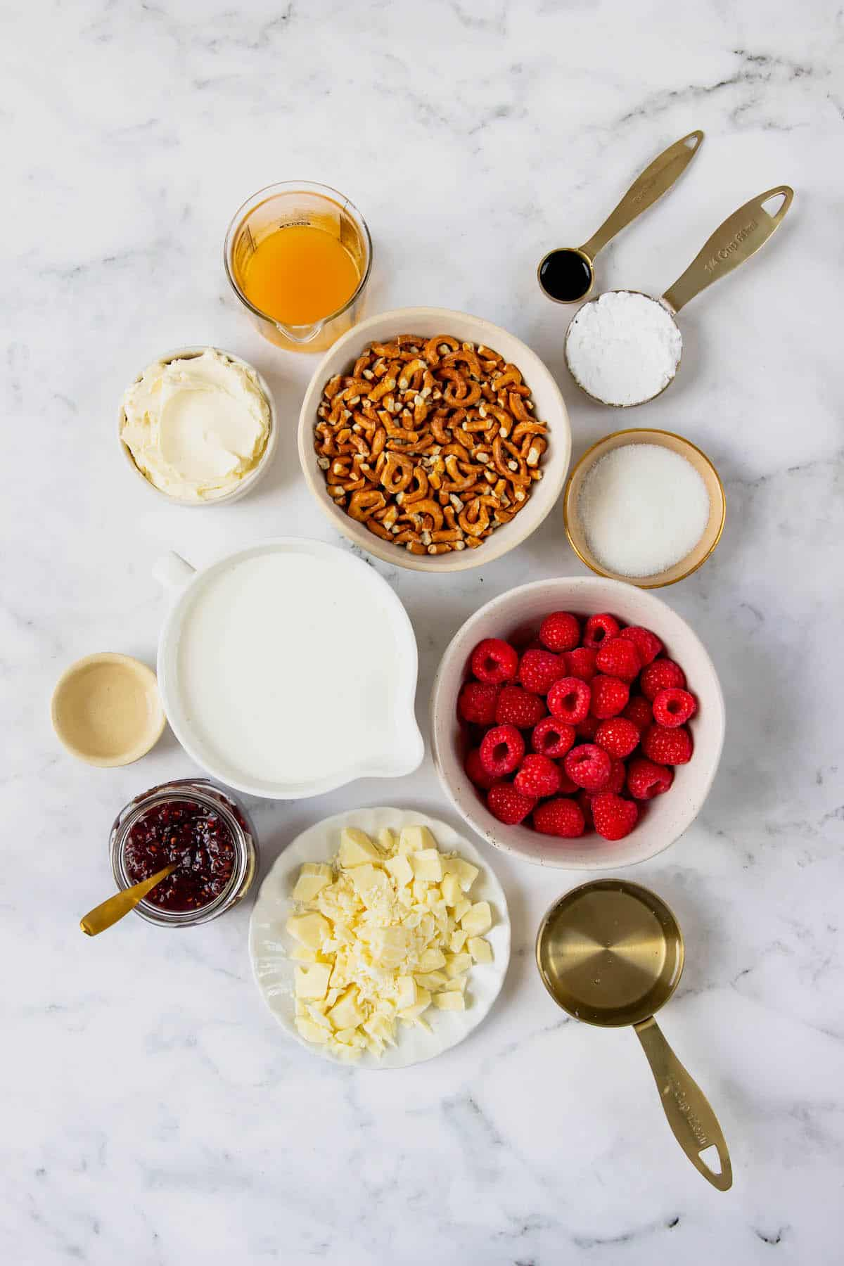 Overhead view of all the ingredients needed for frozen white chocolate raspberry dessert