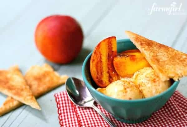 a bowl with grilled peaches, ice cream, and cinnamon pie crust