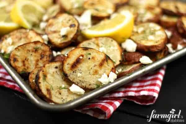 a pan of roasted potatoes with feta and dill