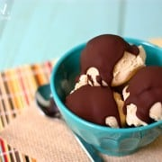 scoops of peanut butter ice cream topped with chocolate magic shell