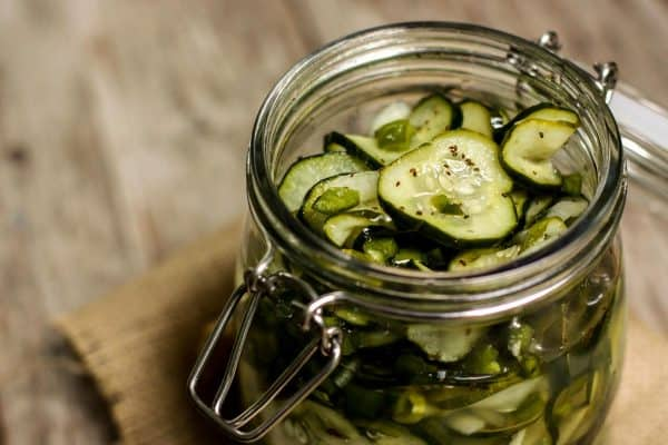 Refrigerator Sweet Pickles from afarmgirlsdabbles.com - A perfect way to preserve all those fresh end-of-summer garden cucumbers. The sweet pickles come together in quick and easy fashion, with a short list of ingredients. And there's no need for any fancy equipment!