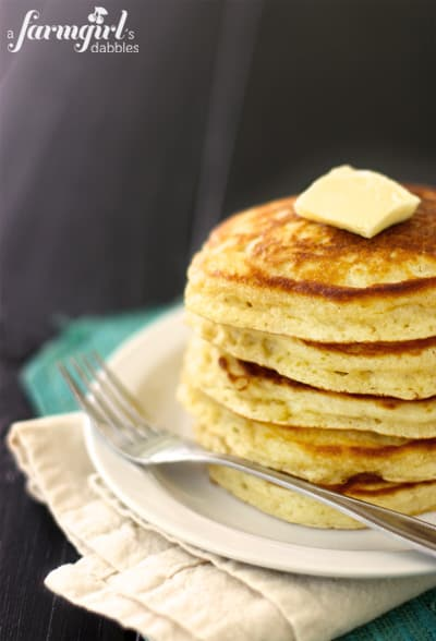 a stack of pancakes with butter