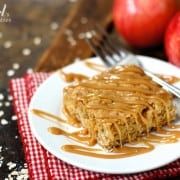 A square of Apple Oatmeal Bars on a plate drizzled with cinnamon caramel sauce