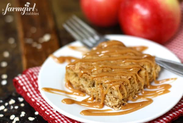 An Apple Oatmeal Bar on a Dish with Caramel Sauce Drizzled on Top