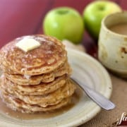 a stack of apple pancakes drizzled with caramel syrup