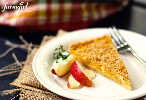 a slice of squash tart with slices of apple