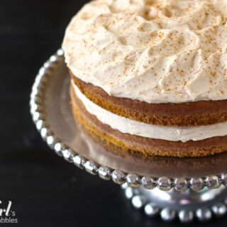 a frosted pumpkin layer cake dusted with cinnamon