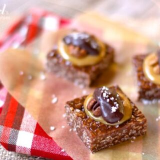 yum-yum bar squares topped with caramel, chocolate, and a pecan