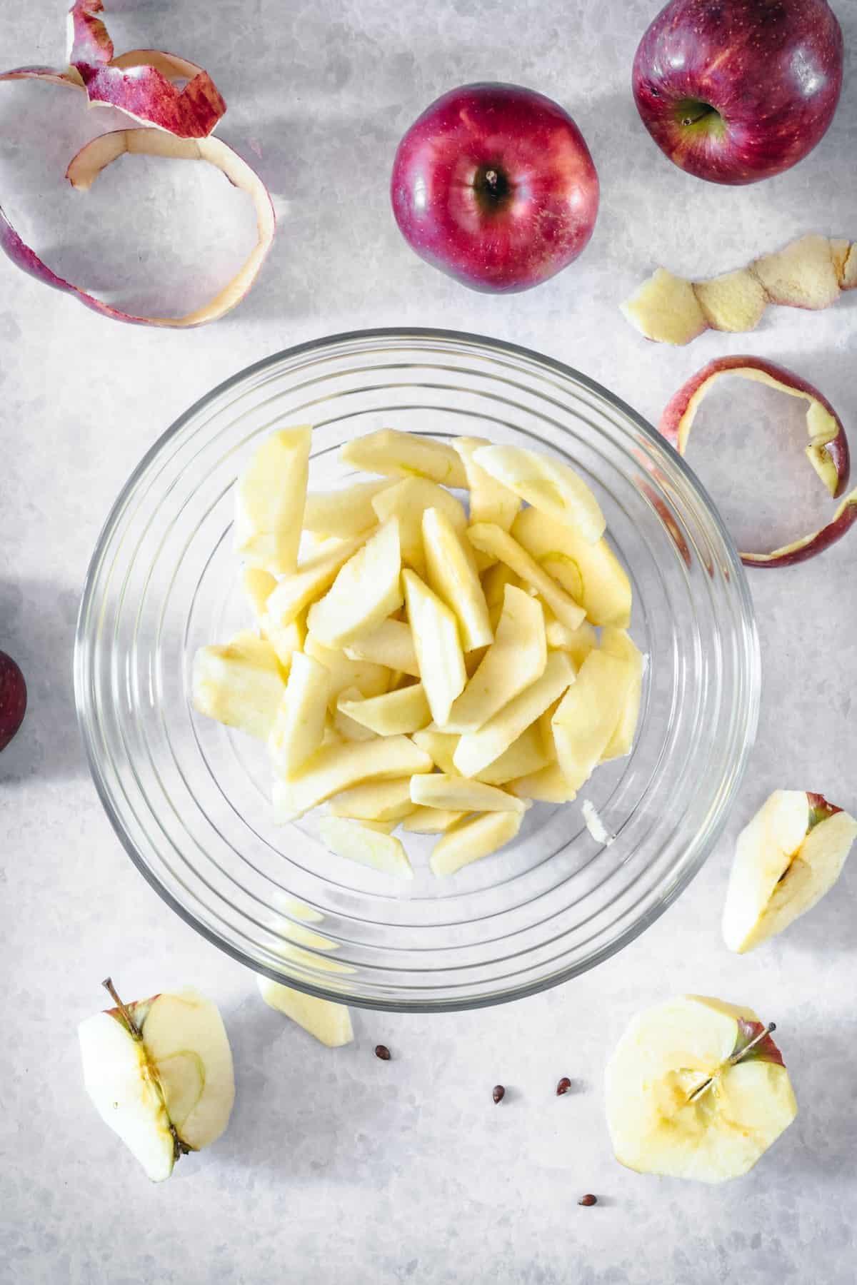 Apple slices in a glass serving dish