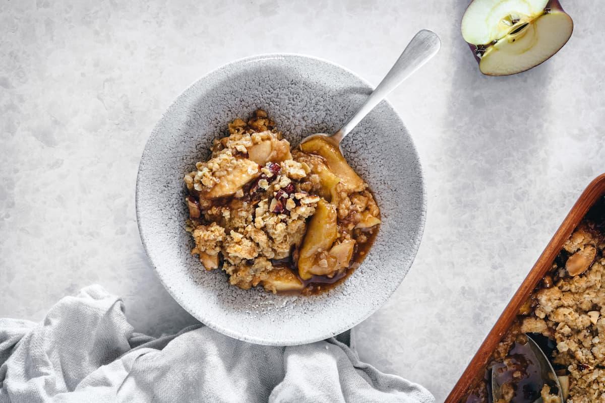 Caramel apple almond crisp in a bowl