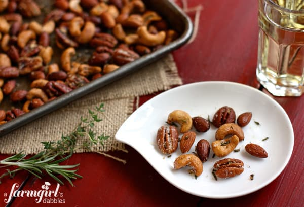 a plate and pan of Rosemary Thyme Spiced Nuts