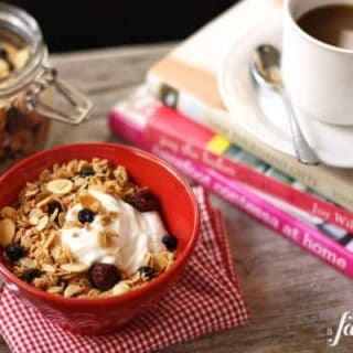 a bowl of yogurt with Granola and a cup of coffee