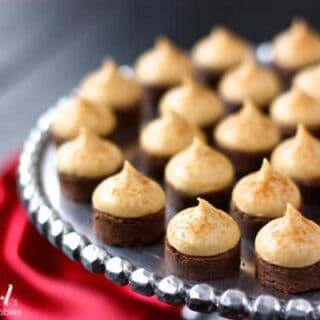espresso brownie bites topped with kahlua buttercream on a silver cake stand