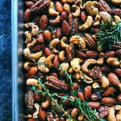 Rosemary Thyme Spiced Nuts on a pan