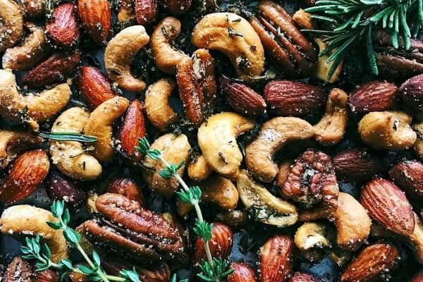 Rosemary Thyme Spiced Nuts from afarmgirlsdabbles.com - This spiced nuts recipe is so easy to make! Lightly spiced and beautifully fragrant with the earthiness of herbs, the nuts are great for nibbling and gifting. #spiced #nuts #rosemary #thyme #appetizer #gifting #foodgift #roasted