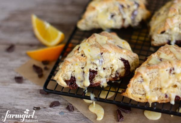 orange and dark chocolate scones topped with orange glaze
