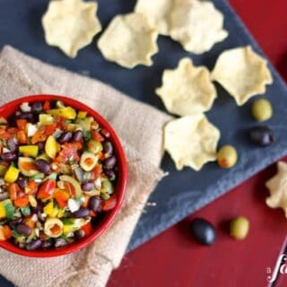 A Bowl of Black Bean Salsa Next to Some Tortilla Chips