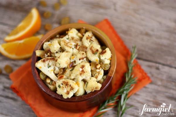 roasted cauliflower with golden raisins + pine nuts + orange
