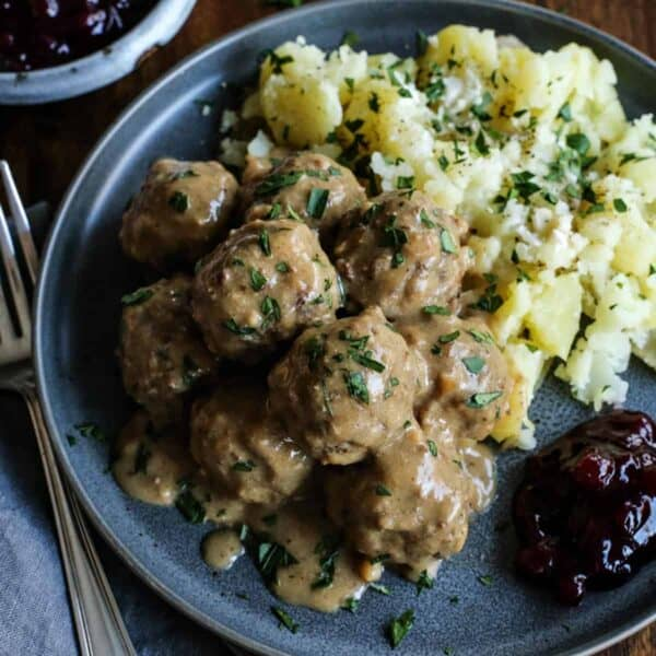 Swedish Meatball Recipe from afarmgirlsdabbles.com - Swedish meatballs are perfectly tender, with an easy-to-make homemade gravy that's creamy and richly flavored. Serve over potatoes or noodles, with a spoonful of traditional tart lingonberry preserves on the side! #swedish #meatball #meatballs #recipe #comfortfood #gravy