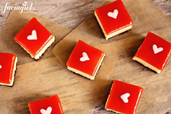 white chocolate cheesecake squares with strawberry glaze