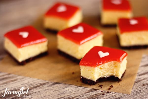 white chocolate cheesecake squares with strawberry glaze
