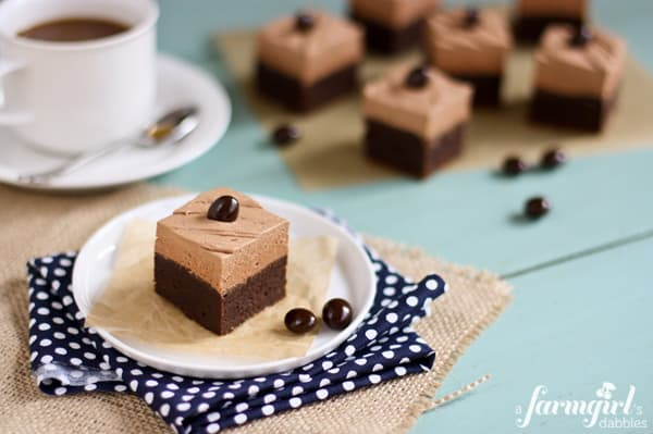 brownie squares topped with mocha buttercream and a chocolate covered coffee bean
